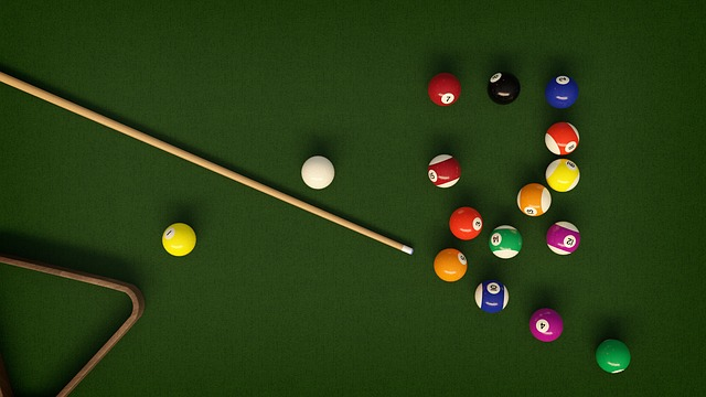 Billiards table shown from above with the balls spread over the table