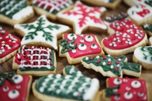 Christmas cookies decorated in white, green and red icing.