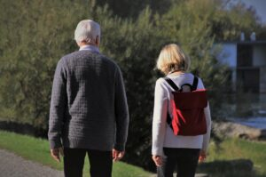 Two seniors walking side by side